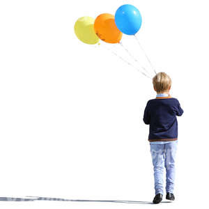 boy with three balloons walking