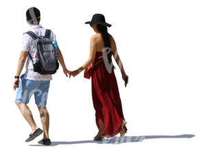 asian couple walking hand in hand in summertime
