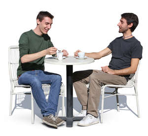 two men sitting in a street cafe and talking