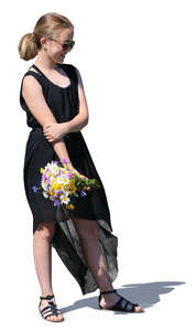 teenage girl with a bouquet of flowers standing