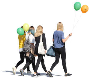 four girls with balloons walking