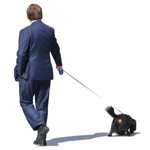 businessman walking a dog