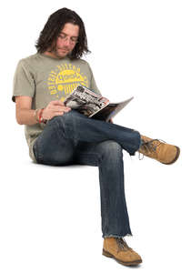 man sitting and reading a magazine
