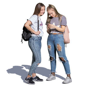 two teenage girls standing and looking at the phone
