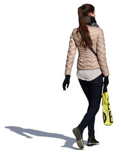 woman with a shopping bag walking