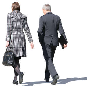 businessman and businesswoman walking