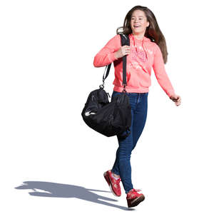 teenage girl with a gym bag walking