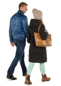 man and woman in winter coats walking