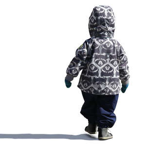 small boy in a hooded jacket walking