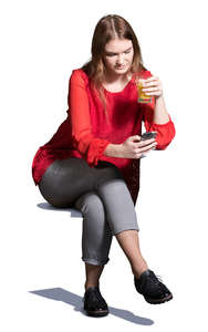 young woman sitting in a cafe and drinking juice