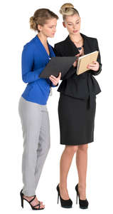 two female office workers looking at their notes