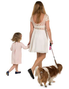 mother and daughter walking with a dog