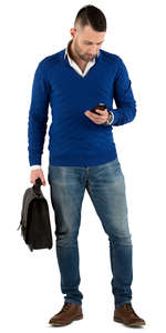 young man with a briefcase standing and texting