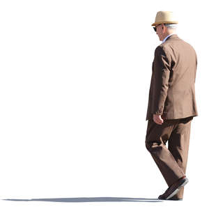 older man in a brown suit walking