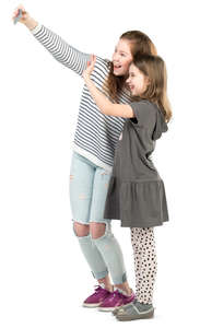 two young girls taking a selfie