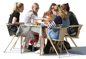 group of women sitting at a street cafe