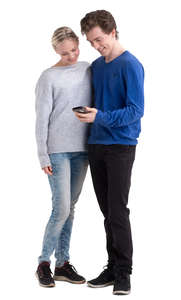 young man and woman standing and looking at a phone