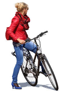 woman with a bicycle standing and looking around
