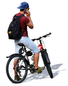 man with a bicycle standing and talking on the phone