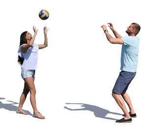 man and woman playing volleyball