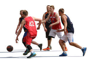 five men playing street basketball