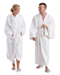 man and woman in white bathrobes walking