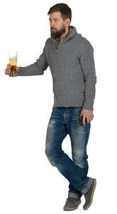 man standing at a bar counter and drinking beer