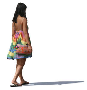 woman in a colorful summer dress walking