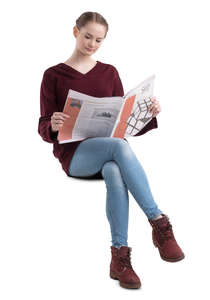 young woman sitting and reading a newspaper