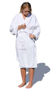 woman standing and tying her bathrobe belt