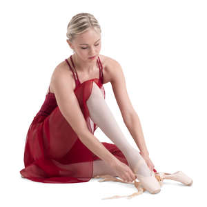 ballerina tying her shoe laces