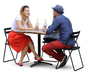 couple sitting in a cafe and drinking ice coffee