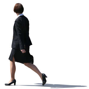businesswoman in a black costume walking on the street