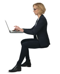 businesswoman sitting behind the desk and working on a computer