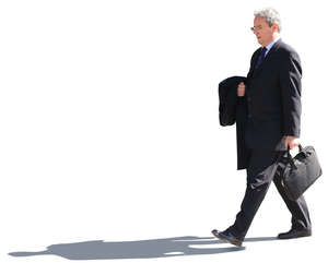senior businessman walking on the street