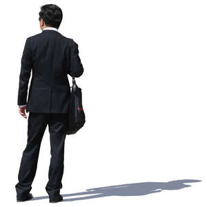 asian businessman in a black suit standing