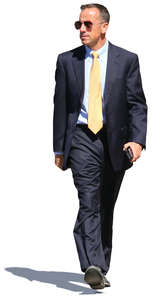 businessman in a dark blue suit walking