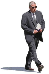 businessman with a striped tie walking