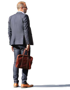 man with a laptop bag standing