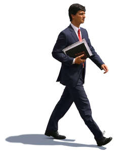 businessman with notebook under his arm walking hastily
