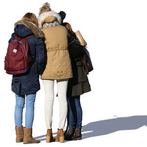 three girls standing in a group