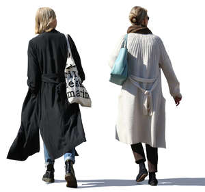 two women in long jackets walking