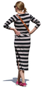woman in a striped dress standing