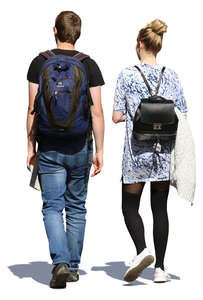 man and woman with backpacks walking in summertime