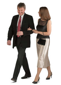 couple in fancy clothes walking arm in arm