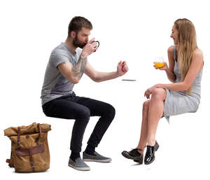 man and woman sitting in a cafe and talking