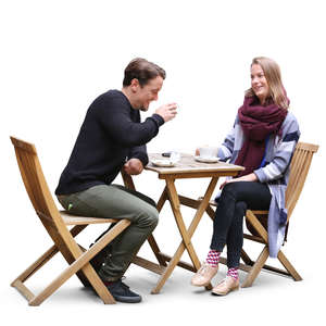 man and woman sitting in a street cafe