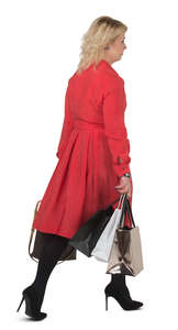 woman in a red dress carrying shopping bags walking