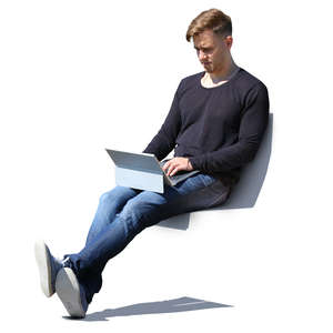 man sitting with laptop on his knees