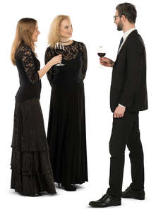 group of three people at a formal gathering standing and talking